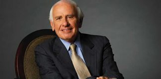 Tony Robbins Mentor - Jim Rohn sitting in a chair